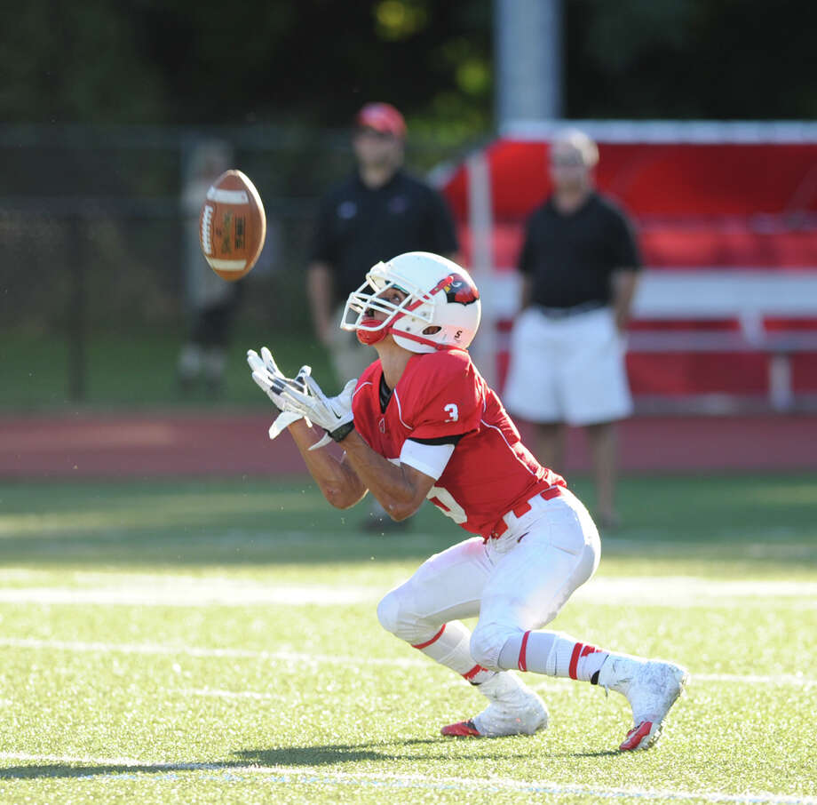 Austin Longi of Greenwich in action during the high school football game between Greenwich High School and New Canaan High School at Greenwich, Saturday, Sept. 28, 2013. Photo: Bob Luckey / Greenwich Time