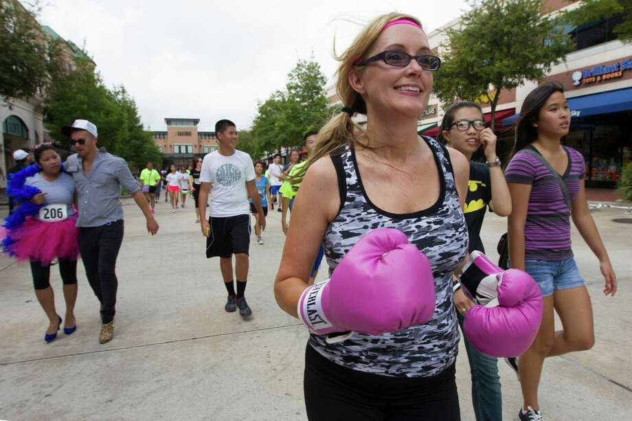 Ricci Rodgers wears her pink boxing gloves in support of her mother during the third annual Houston Stiletto Stampede at town center on Saturday, Sept. 28, 2013, in Sugar Land. Photo: J. Patric Schneider, For The Chronicle / © 2013 Houston Chronicle