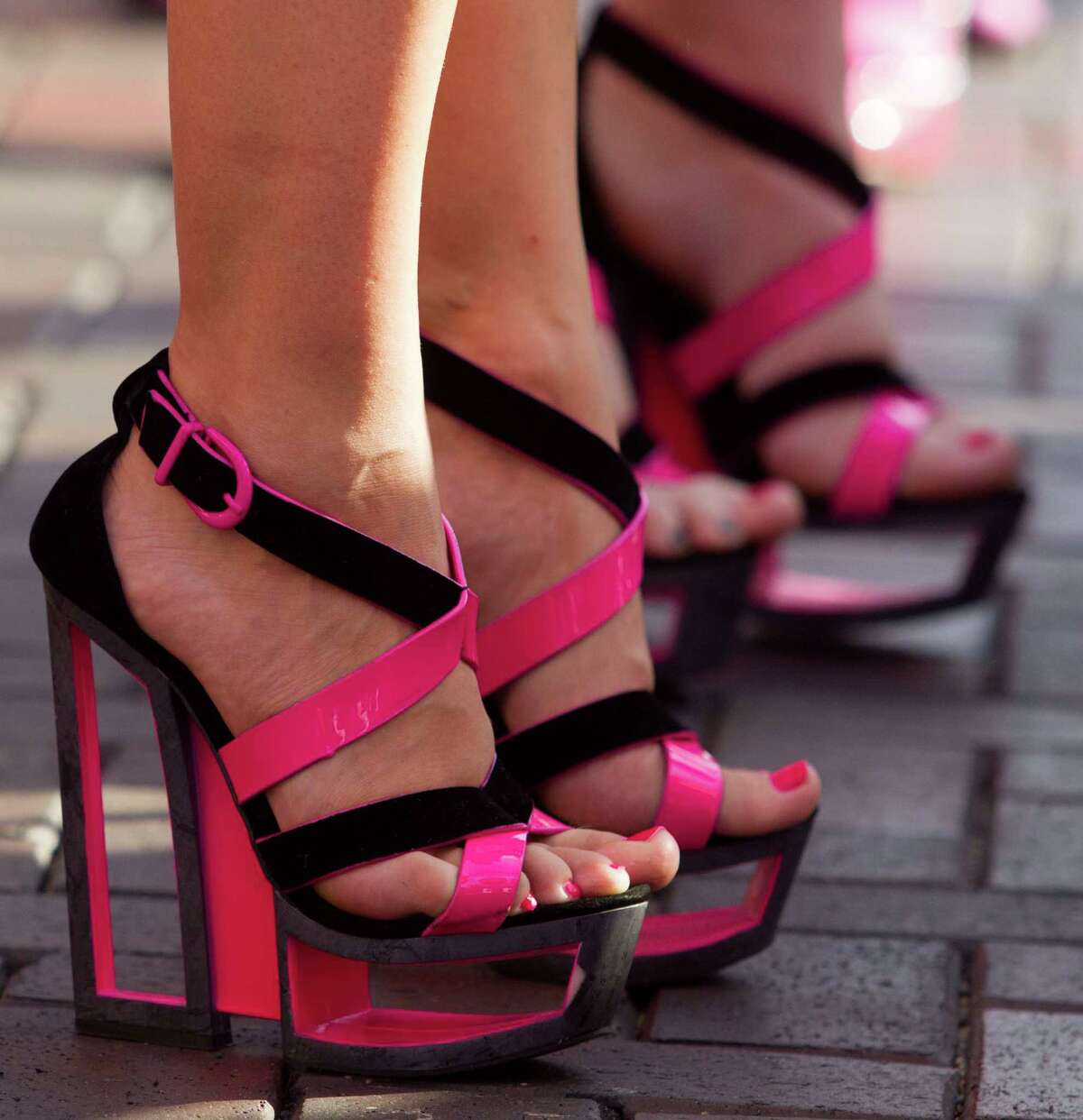 Participants show off their high heels during the third annual Houston Stiletto Stampede at Town Center on Saturday, Sept. 28, 2013, in Sugar Land. The Stiletto Stampede is a 100-yard high heel dash with a mission to encourage young women and men to understand the risks of breast cancer and empower them to prevent the disease by utilizing overall breast self-awareness through early detection and screening methods.
