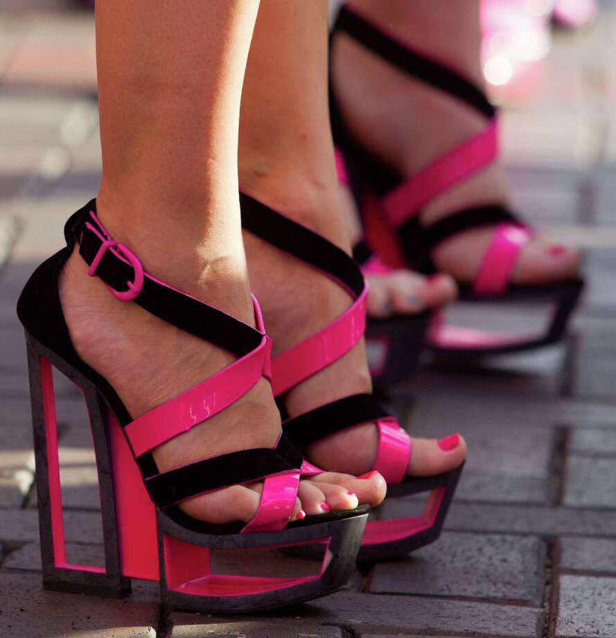 Participants show off their high heels during the third annual Houston Stiletto Stampede at Town Center on Saturday, Sept. 28, 2013, in Sugar Land. The Stiletto Stampede is a 100-yard high heel dash with a mission to encourage young women and men to understand the risks of breast cancer and empower them to prevent the disease by utilizing overall breast self-awareness through early detection and screening methods. Photo: J. Patric Schneider, For The Chronicle / © 2013 Houston Chronicle