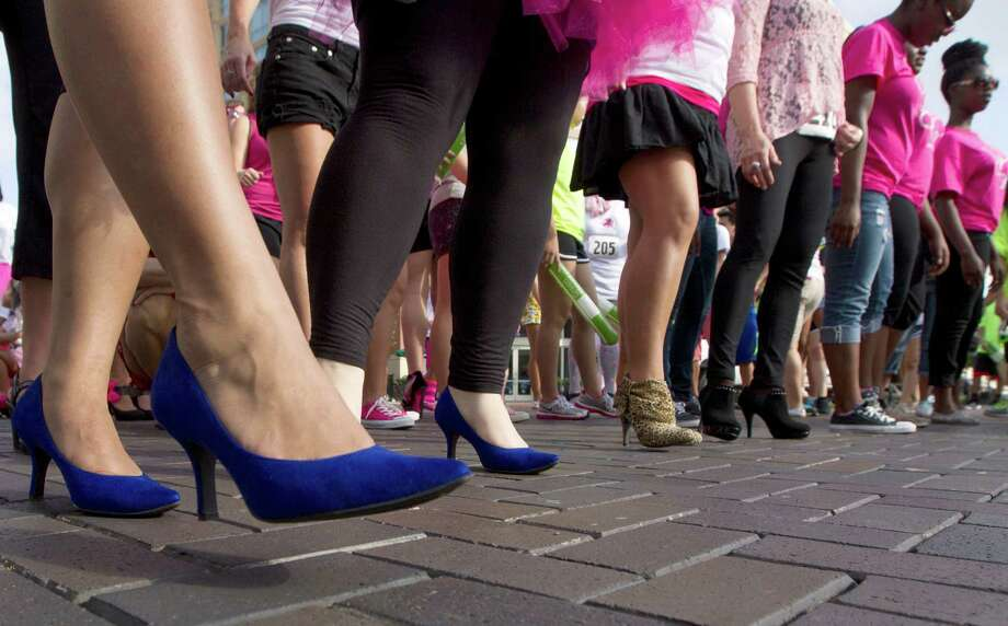 Participants show off their high heels during the third annual Houston Stiletto Stampede at Town Center on Saturday, Sept. 28, 2013, in Sugar Land. Photo: J. Patric Schneider, For The Chronicle / © 2013 Houston Chronicle
