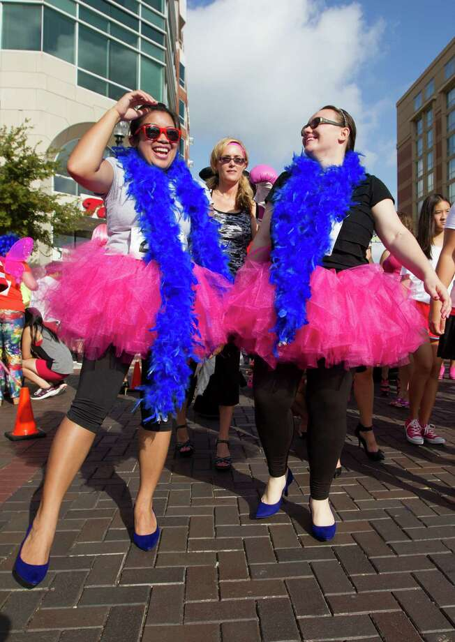 Libby Landicho and Minela Bajrovic participate in the third annual Houston Stiletto Stampede. Photo: J. Patric Schneider, For The Chronicle / © 2013 Houston Chronicle