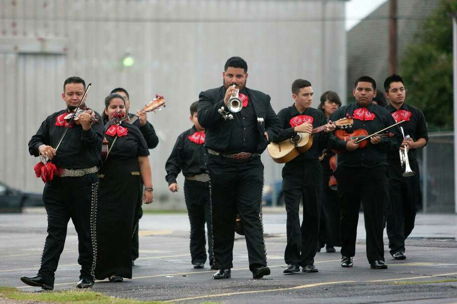 Mariachi Serenata Juvenil performs as they walk down the 1700 block of Lubbock Street before performing at the St. Joseph Catholic Church Fall Festival near downtown Saturday, Sept. 28, 2013, in Houston. Photo: Johnny Hanson, Houston Chronicle / Houston Chronicle