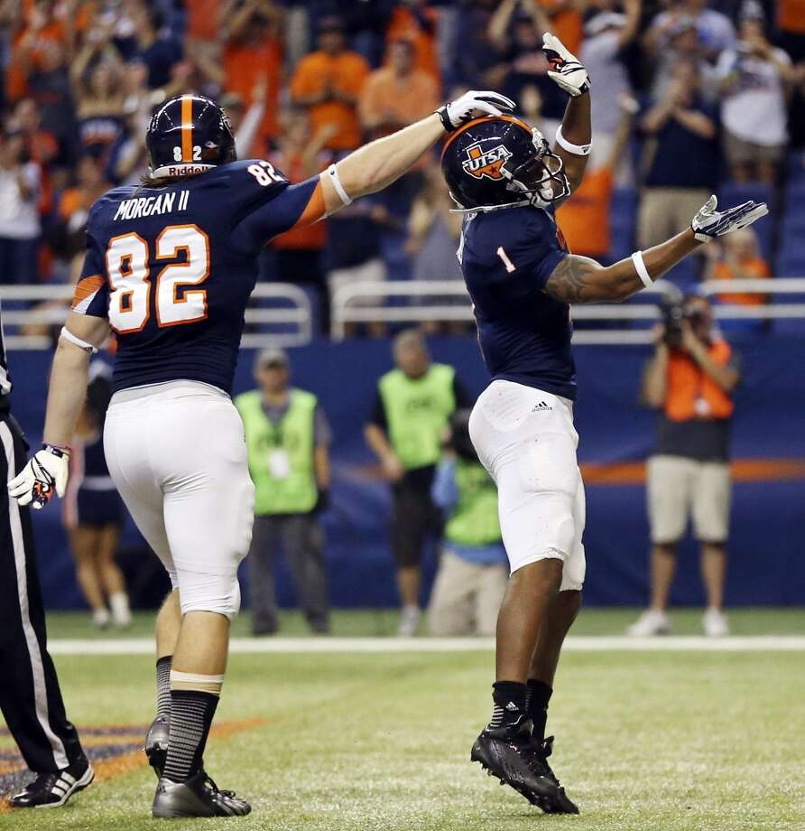 UTSA' s David Morgan II (left) celebrates with teammate Kam Jones after Jones scored a touchdown against the University of Houston during first half action Saturday Sept. 28, 2013 at the Alamodome. Photo: San Antonio Express-News