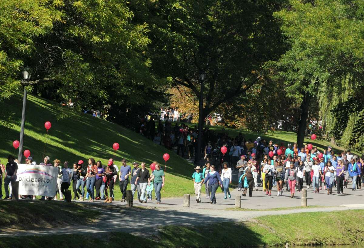 Participants take part in the 17th annual AIDSWalk at Albanya€™s Washington Park on Saturday Sept. 28, 2013 in Albany, N.Y. (Michael P. Farrell/Times Union)