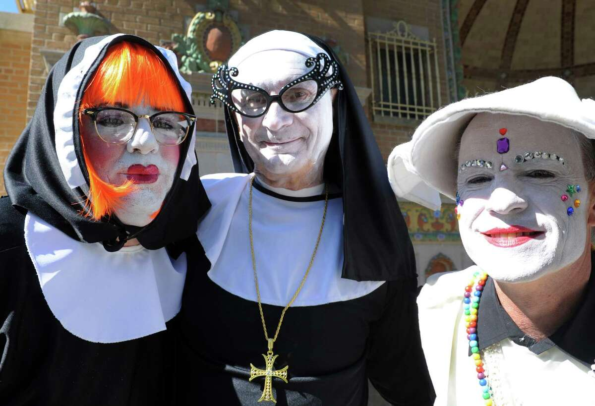 The Sisters Stevem Holmes, left, Ed Countermine and Adam Brady take part in the festivities prior to the 17th annual AIDSWalk at Albanya€™s Washington Park on Saturday Sept. 28, 2013 in Albany, N.Y. (Michael P. Farrell/Times Union)