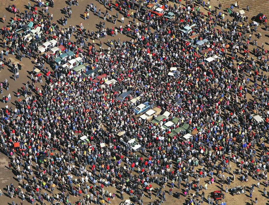 Crowds converge on an auction of low-mileage vintage Chevrolets that drew car buffs from around the world to Pierce, Neb. The auction fetched more than $545,000 on Saturday. Photo: Dave Tunge / Dakota Aerials