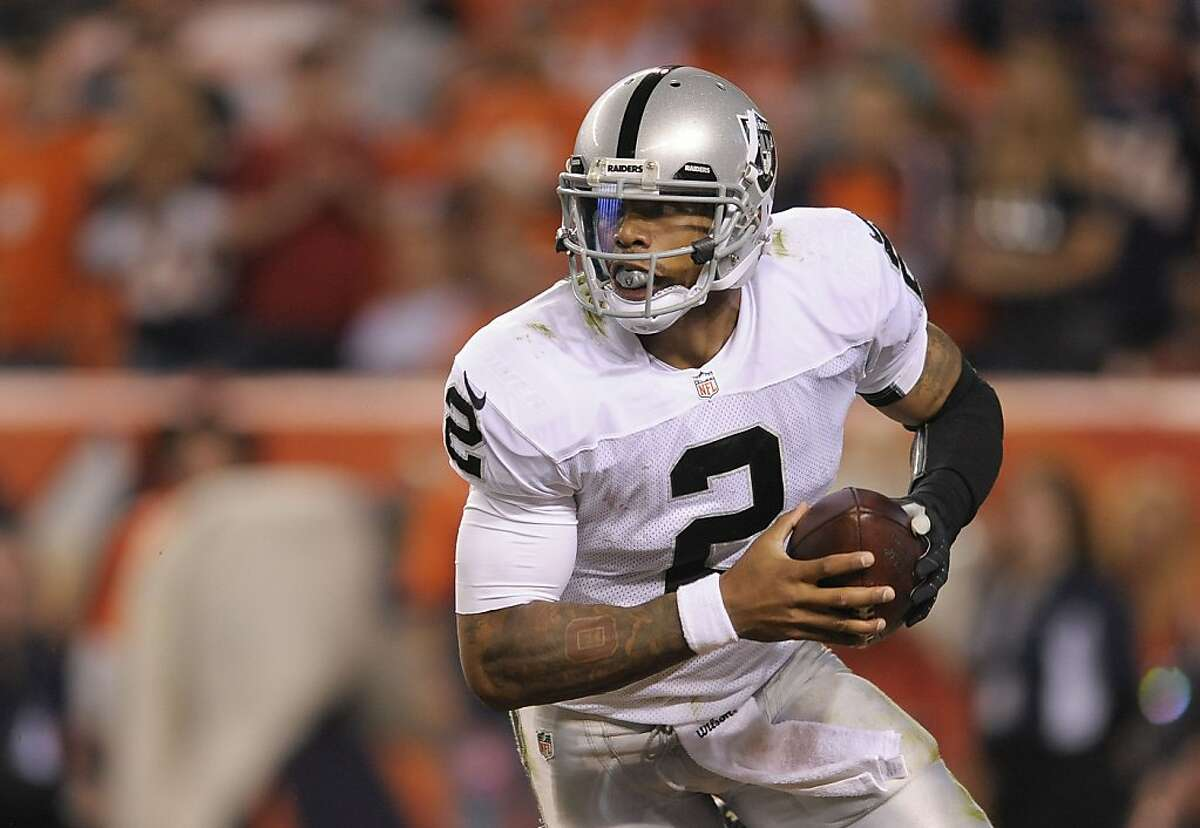 Oakland Raiders quarterback Terrelle Pryor (2) rolls out of the pocket against the Denver Broncos in the third quarter of an NFL football game, Monday, Sept. 23, 2013, in Denver. (AP Photo/Jack Dempsey)