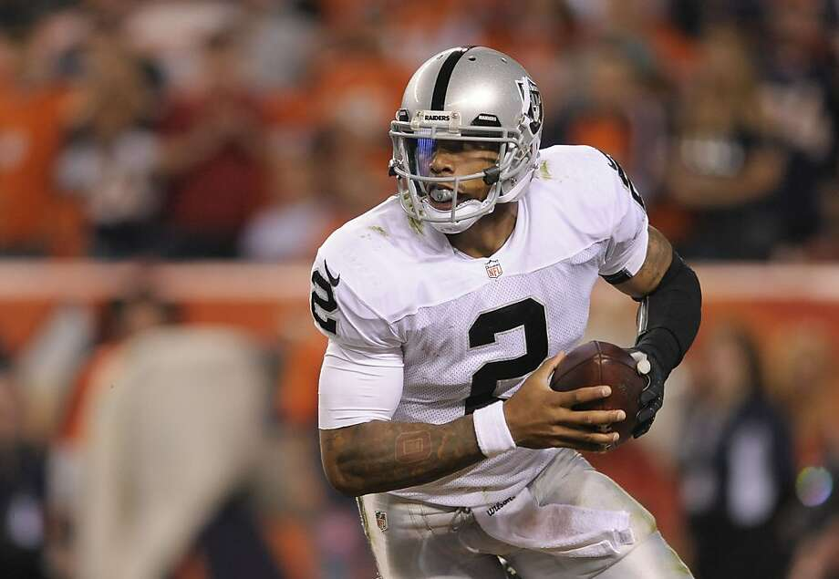 Oakland Raiders quarterback Terrelle Pryor (2) rolls out of the pocket against the Denver Broncos in the third quarter of an NFL football game, Monday, Sept. 23, 2013, in Denver. (AP Photo/Jack Dempsey) Photo: Jack Dempsey, Associated Press