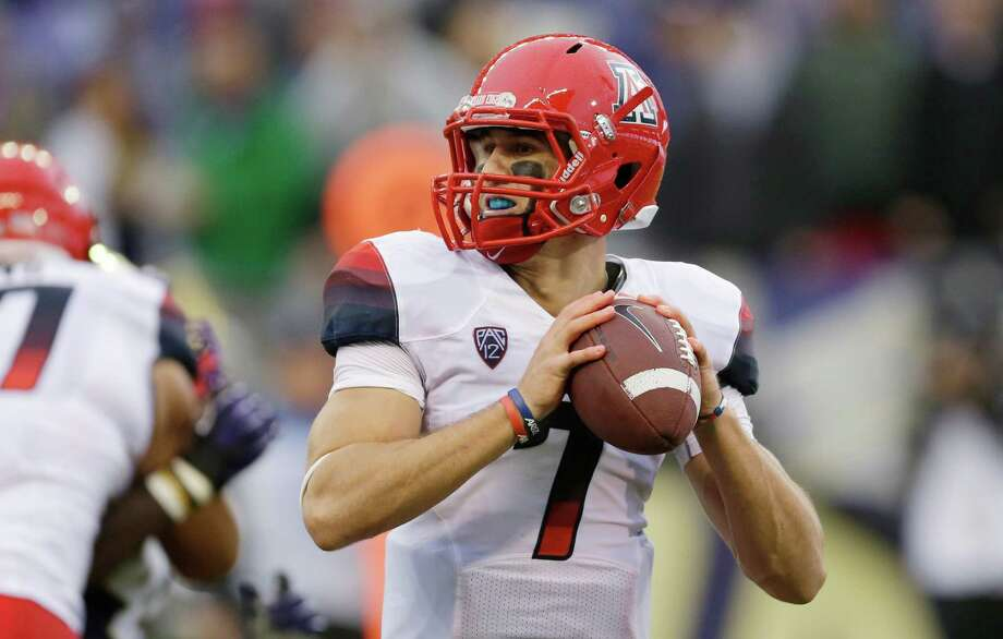 Arizona quarterback B.J. Denker looks to throw in the first half. Photo: AP