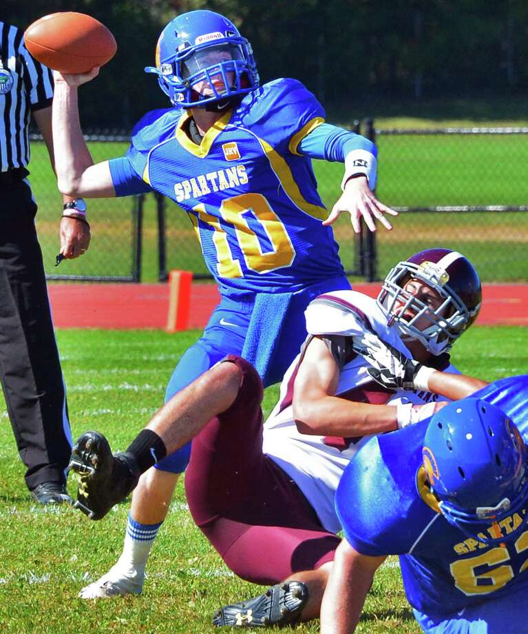 Queensbury QB #10 Drew Wilson gets off a pass during their game against Burnt Hills Saturday Sept. 28, 2013, in Queensbury, NY. (John Carl D'Annibale / Times Union) Photo: John Carl D'Annibale / 00024014A