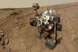 This NASA photo is a self-portrait taken by Curiosity in Gale Crater, where the rover landed last year