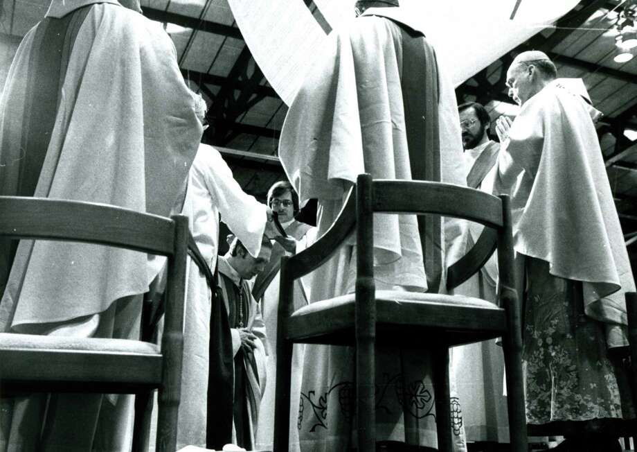 Bishop Howard Hubbard, center, is ordained as bishop of Albany on March 27, 1977, at Siena College in Loudonville, N.Y.   (Fred McKinney/Times Union archive)