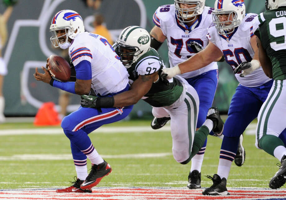 New York Jets outside linebacker Calvin Pace (97) sacks Buffalo Bills quarterback EJ Manuel (3) during the second half of an NFL football game Sunday, Sept. 22, 2013, in East Rutherford, N.J. (AP Photo/Bill Kostroun)  ORG XMIT: ERU120 Photo: Bill Kostroun / FR51951 AP