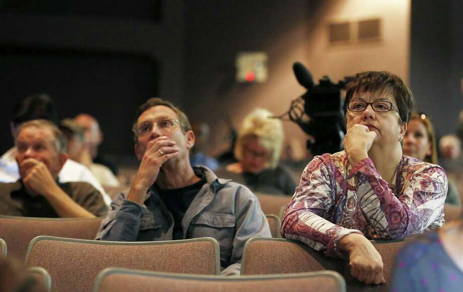 Ana Maria Fraijo (right) and Steve Maslansky listen to the official report on how the 19 hotshot firefighters died battling an Arizona wildfire. Photo: Ross D. Franklin / Associated Press