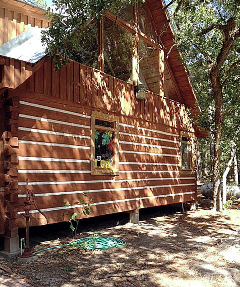 Doug Masters built the family cabin out of pines from the property and also used white sand from the property for the mortar at the 53-acre La La Land Ranch south of Huntsville. Photo: Joe Holley, Houston Chronicle / © 2013 Houston Chronicle