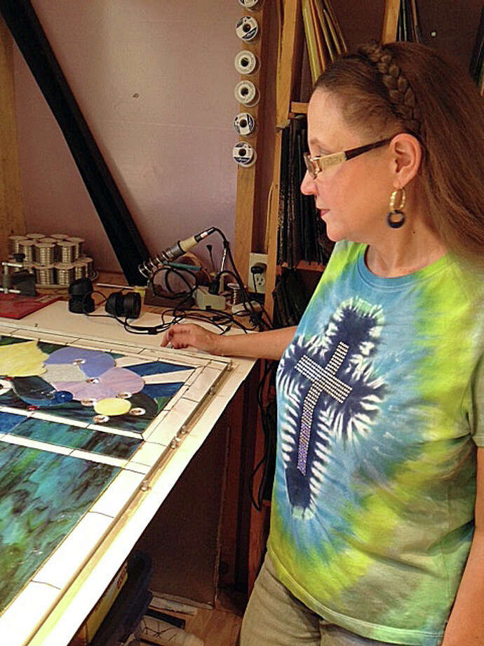 Linda Masters has been working for two years on stained glass windows for the historic Moscow Baptist Church at the 53-acre La La Land Ranch south of Huntsville. Photo: Joe Holley, Houston Chronicle / © 2013 Houston Chronicle