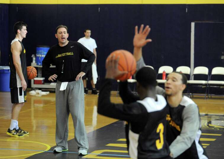 Coach Will Brown, left, runs the UAlbany men's basketball team through their first practice of the s