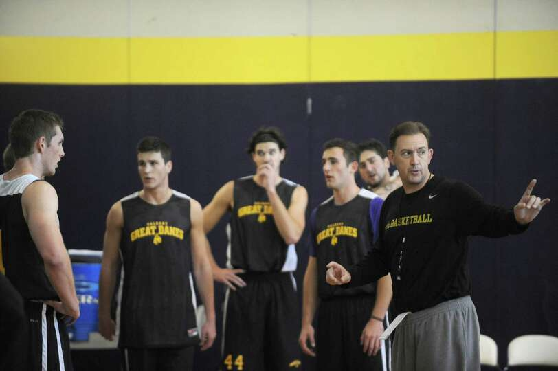 Coach Will Brown, right, runs the UAlbany men's basketball team through their first practice of the