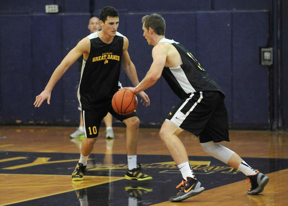Michael Rowley, left, and Luke Devlin guard each other as the UAlbany men's basketball team held their first practice of the season on Saturday Sept. 28, 2013 in Albany, N.Y. (Michael P. Farrell/Times Union) Photo: Michael P. Farrell / 00024002A