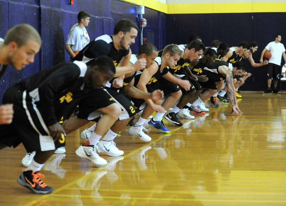 Coach Will Brown, runs the UAlbany men's basketball team through their first practice of the season on Saturday Sept. 28, 2013 in Albany, N.Y. (Michael P. Farrell/Times Union) Photo: Michael P. Farrell / 00024002A