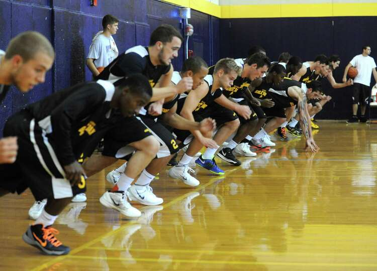 Coach Will Brown, runs the UAlbany men's basketball team through their first practice of the season