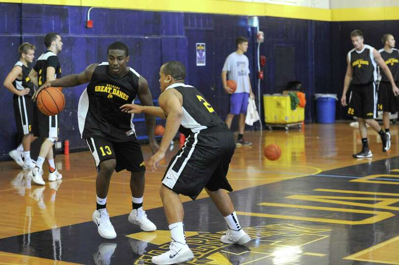 Reece Williams, left, and Stephan Jiggetts guard each other as the UAlbany men's basketball team hel