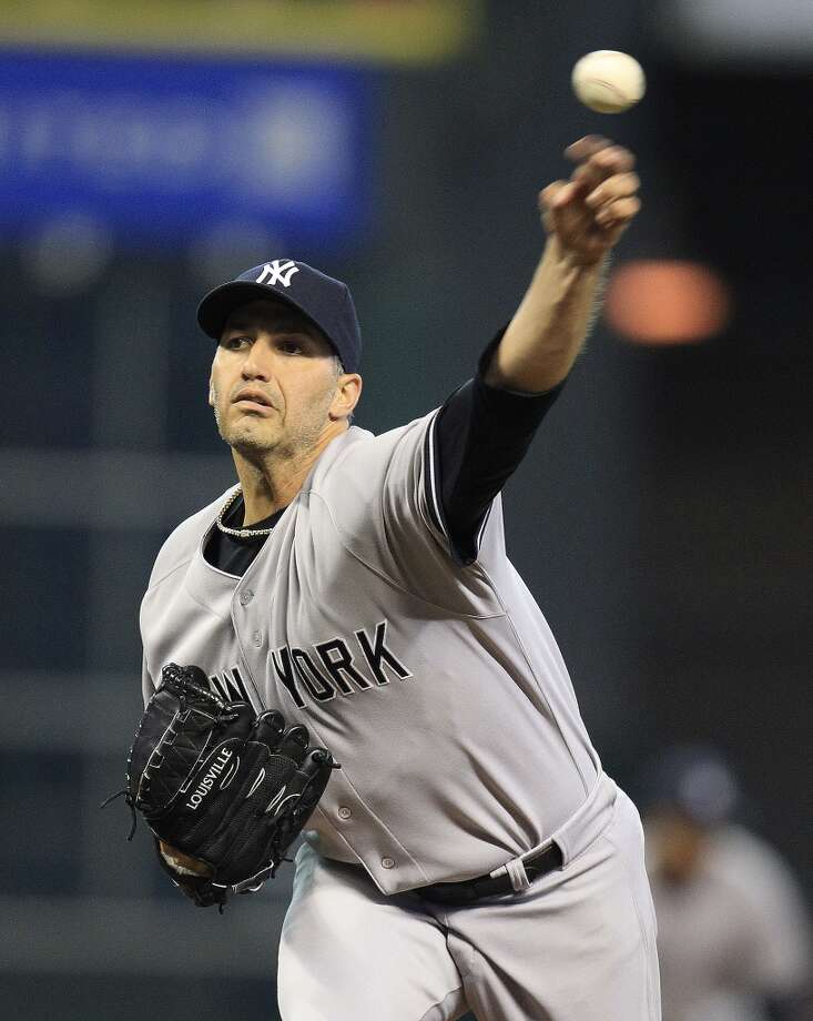 Yankees starting pitcher Andy Pettitte (46) warms up. Photo: Karen Warren, Houston Chronicle