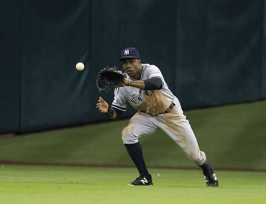Yankees center fielder Curtis Granderson (14) catches a single hit by Astros catcher Matt Pagnozzi (44). Photo: Karen Warren, Houston Chronicle