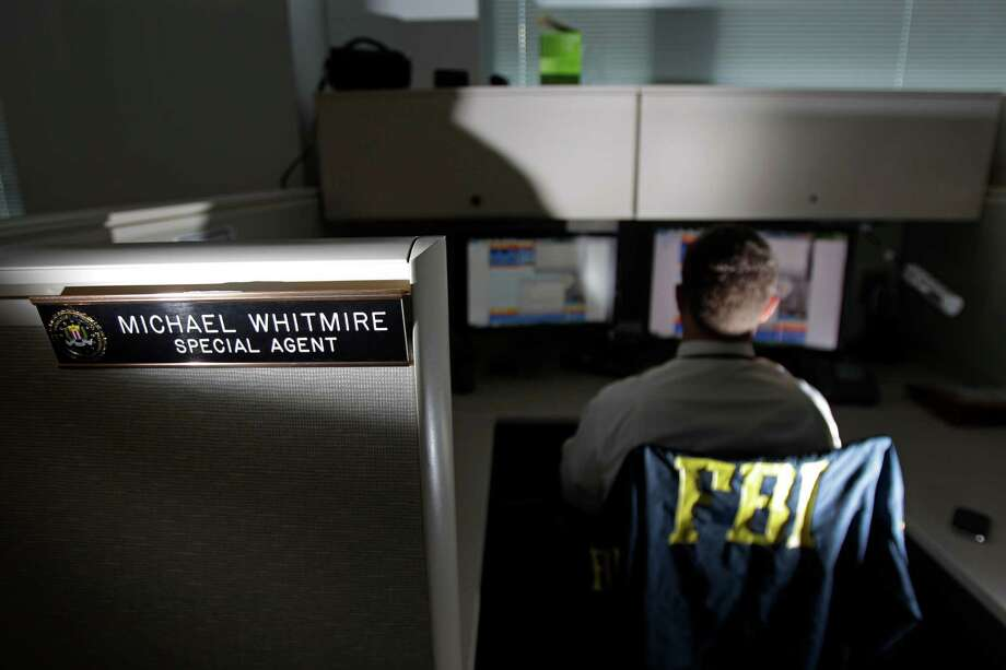 FBI special agent Michael Whitmire works on the Houston Area Child Exploitation Task Force. He works online, posing as a child to catch online adult predators who try to entice children into sexual activities. Photo: Melissa Phillip, Staff / © 2013  Houston Chronicle