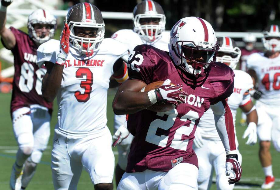 Union College running back Darnel Thomas breaks for a long gain during their men's college football game against visiting St. Lawrence on Saturday Sept. 28, 2013 in Schenectady, N.Y. (Michael P. Farrell/Times Union) Photo: Michael P. Farrell / 00023992A