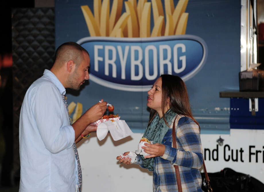Matthew Boccuzzi, of Norwalk, and his sister Alyssa, of Bridgeport, eat some french fries outside before heading in to see Tegan and Sara and Fun perform at the Webster Bank Arena in Bridgeport, Conn. on Saturday September 28, 2013. Fun, who won the Grammy Awards for Best New Artist and Song of the Year, were the headlining act. Photo: Christian Abraham / Connecticut Post