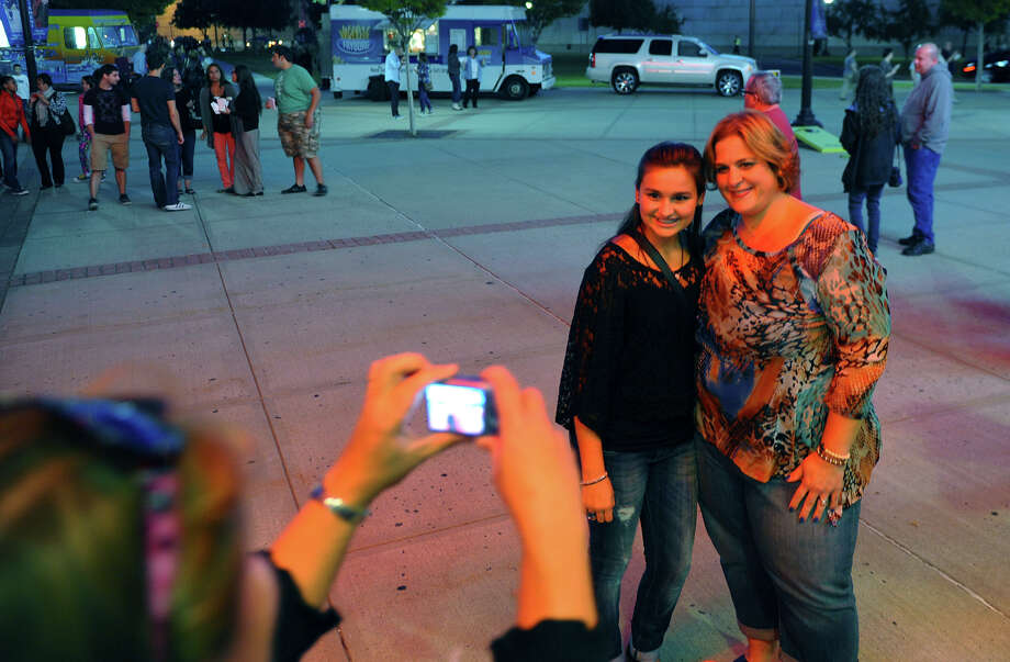 Sheri Perez, of Norwalk, poses for a photo with her daughter Briana, 13, while outside waiting to see Tegan and Sara and Fun perform at the Webster Bank Arena in Bridgeport, Conn. on Saturday September 28, 2013. Fun, who won the Grammy Awards for Best New Artist and Song of the Year, were the headlining act. Photo: Christian Abraham / Connecticut Post