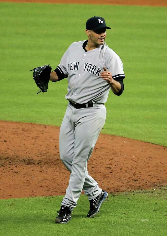 HOUSTON, TX - SEPTEMBER 28:  Andy Pettitte #46 of the New York Yankees celebrates after pitching his last game and defeating the Houston Astros 2-1 at Minute Maid Park on September 28, 2013 in Houston, Texas.  (Photo by Scott Halleran/Getty Images) ORG XMIT: 163495796 Photo: Scott Halleran / 2013 Getty Images