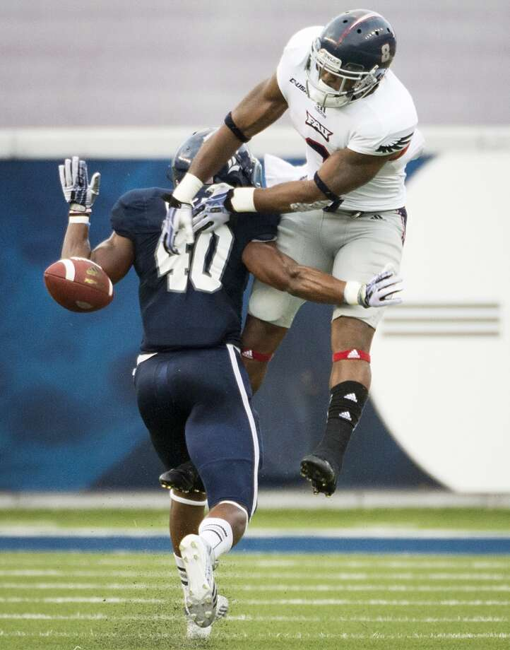 Sept 28: Rice 18, FAU 14Record: 2-2Rice safety Gabe Baker (40) breaks up a pass intended for Florida Atlantic wide receiver Daniel McKinney (8). Photo: Smiley N. Pool, Houston Chronicle