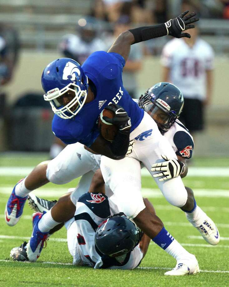Cy-Creek running back Terrell Aldridge looks for extra yards during the first half of a high school football game against Cy-Spring at Pridgeon stadium on Saturday, Sept. 28, 2013, in Houston. Photo: J. Patric Schneider, For The Chronicle / © 2013 Houston Chronicle