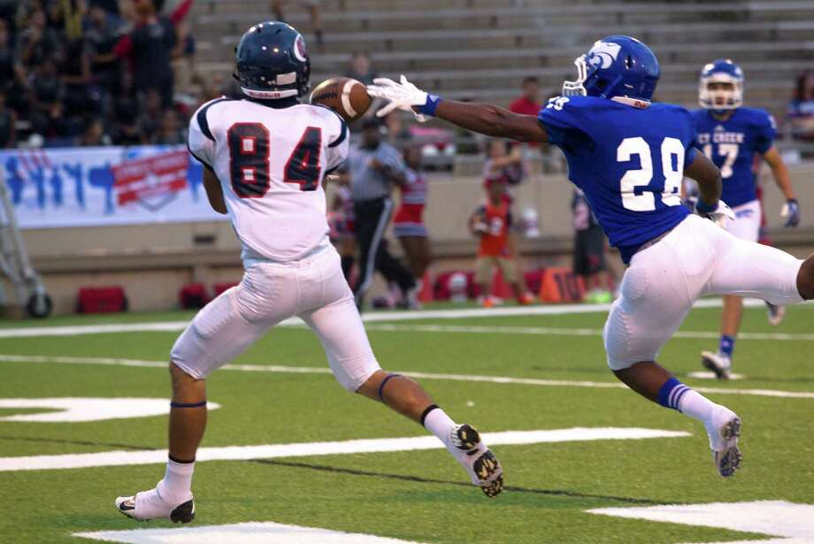 Cy-Creek  defensive back Devin Kelly (28) breaks up a pass intended for Cy-Spring wide receiver Jason Schilling (84) during the first half of a high school football game at Pridgeon stadium on Saturday, Sept. 28, 2013, in Houston. Photo: J. Patric Schneider, For The Chronicle / © 2013 Houston Chronicle