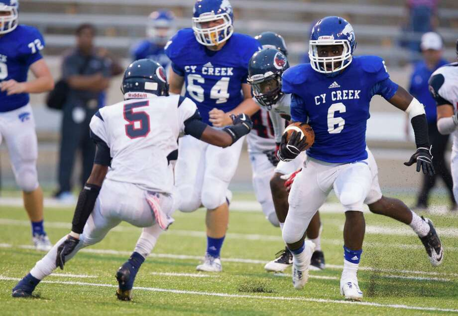 Cy-Creek running back Terrell Aldridge (6) looks for running room  during the first half of a high school football game against Cy-Springs at Pridgeon stadium on Saturday, Sept. 28, 2013, in Houston. Photo: J. Patric Schneider, For The Chronicle / © 2013 Houston Chronicle