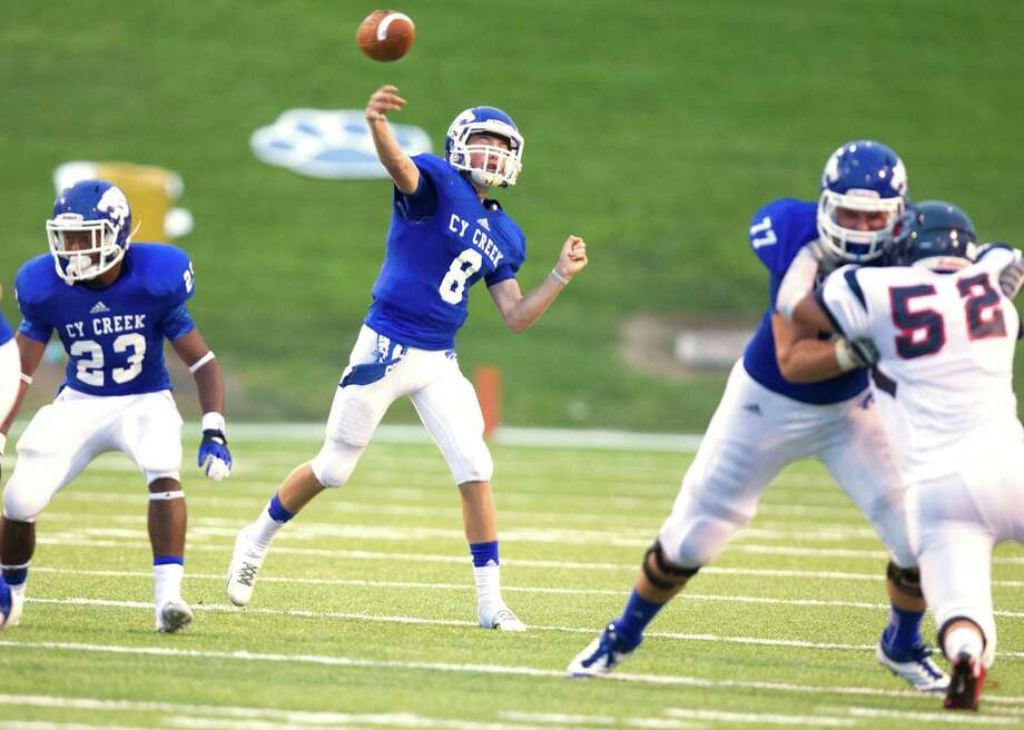 Cy-Creek quarterback Ross Hargrove (8) throws a pass during the first half of a high school football game against Cy-Spring at Pridgeon stadium on Saturday, Sept. 28, 2013, in Houston. Photo: J. Patric Schneider, For The Chronicle / © 2013 Houston Chronicle