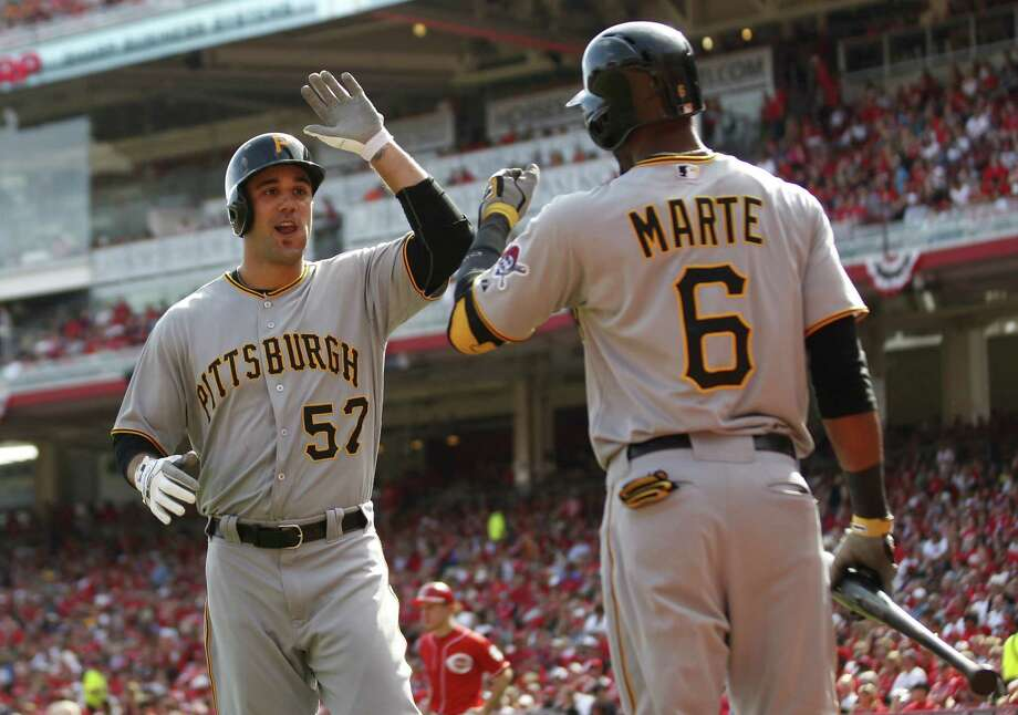 Pittsburgh's Andrew Lambo is congratulated by Starling Marte after hitting a solo homer. Photo: John Sommers II / Getty Images