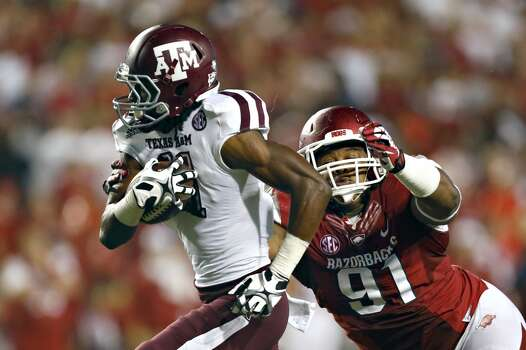 Texas A&M 45, Arkansas 33Record: 4-1  Derel Walker #11 of the Aggies runs the ball after catching a pass and is pursued by Darius Philon #91 of the Razorbacks. Photo: Wesley Hitt, Getty Images