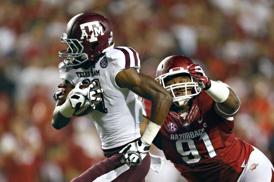 Texas A&M 45, Arkansas 33Record: 4-1Derel Walker #11 of the Aggies runs the ball after catching a pass and is pursued by Darius Philon #91 of the Razorbacks. Photo: Wesley Hitt, Getty Images