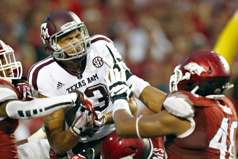 Mike Evans #13 of the Aggies catches a touchdown pass. Photo: Wesley Hitt, Getty Images