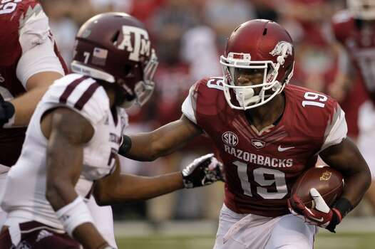 Arkansas wide receiver Javontee Herndon (19) carries against Texas A&M defensive back Tramain Jacobs (7). Photo: Danny Johnston, Associated Press