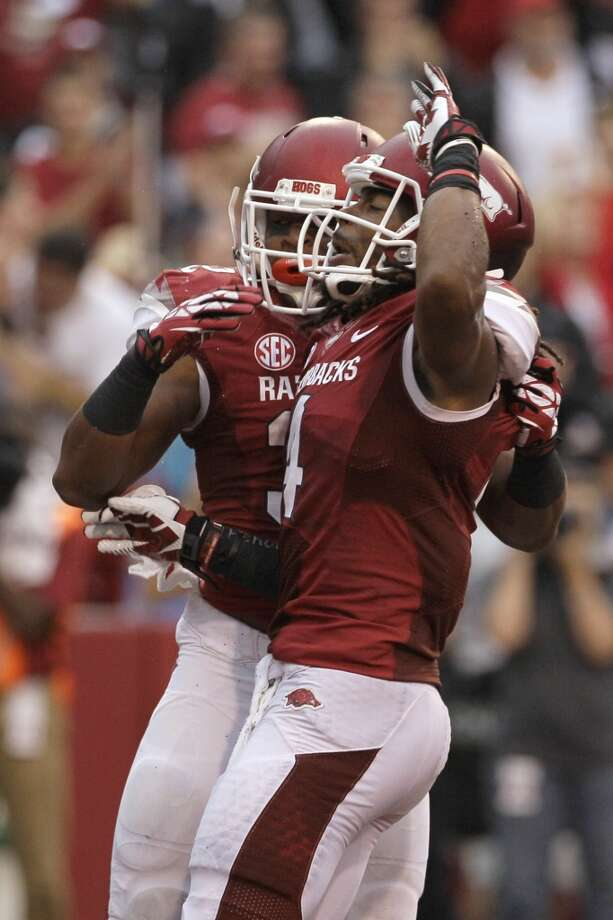 Arkansas running back Jonathan Williams, left, and wide receiver Keon Hatcher celebrate Hatcher's first-quarter touchdown. Photo: Danny Johnston, Associated Press