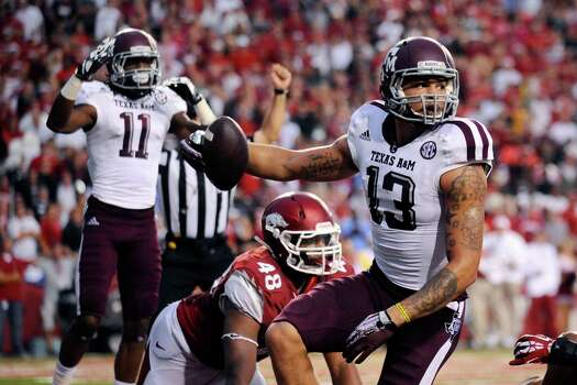 As is normally the case, Texas A&M wide receiver Mike Evans comes down the football, beating Deatrich Wise Jr. (48) among other Arkansas defenders on a second-quarter touchdown reception. Photo: Beth Hall, FRE / FR129439 AP