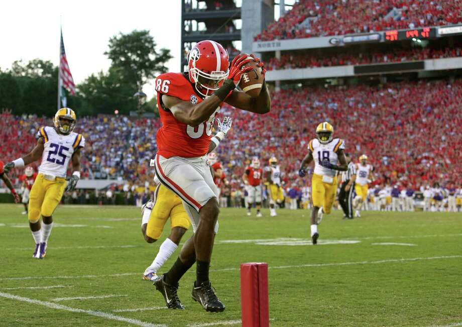 Georgia wide receiver Justin Scott-Wesley (86) scores a 25-yard go-ahead touchdown from quarterback Aaron Murray during a 44-41 win over LSU in an NCAA college football game on Saturday, Sept. 28, 2013, in Athens, Ga. (AP Photo/Atlanta Journal-Constitution, Jason Getz )  MARIETTA DAILY OUT; GWINNETT DAILY POST OUT; LOCAL TV OUT; WXIA-TV OUT; WGCL-TV OUT  ORG XMIT: GAATJ902 Photo: Jason Getz / Atlanta Journal-Constitution
