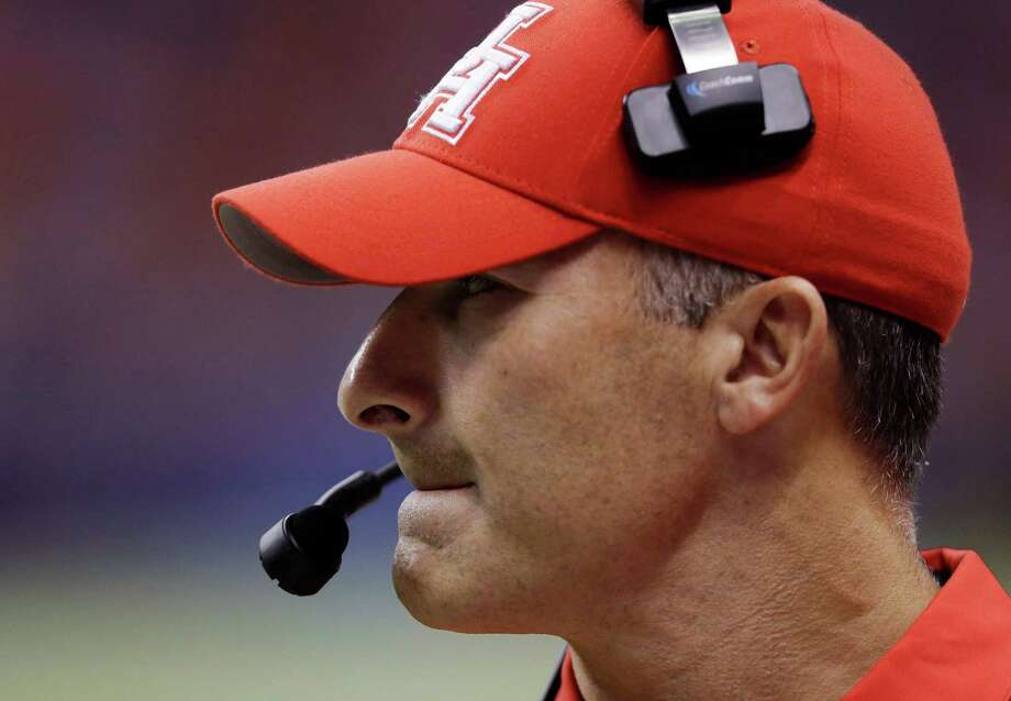 Houston head coach Tony Levine watches from the sidelines during the first half of an NCAA college football game against Texas San Antonio, Saturday, Sept. 28, 2013, in San Antonio. (AP Photo/Eric Gay) Photo: Eric Gay, Associated Press / AP