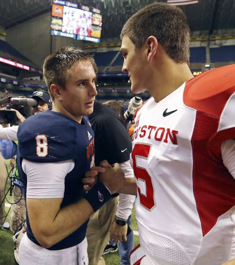 UTSA' s  Eric Soza (left) talks with University of Houston's John O'Korn after the game Saturday Sept. 28, 2013 at the Alamodome. The University of Houston won 59-28. Photo: San Antonio Express-News