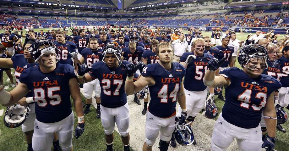 Members of the UTSA football team gather for the school songs after the game with the University of Houston Saturday Sept. 28, 2013 at the Alamodome. The University of Houston won 59-28. Photo: San Antonio Express-News